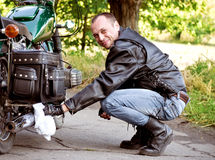 Man sitting by motorcycle Royalty Free Stock Image