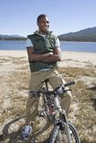 Man Sitting On Mountain Bike By The Lake Stock Images