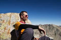 Man Sitting On Mountain Top Royalty Free Stock Photography
