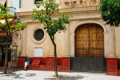 Man sitting near entrance to church at hospital Royalty Free Stock Image