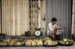 Man Sitting Near Fruits Royalty Free Stock Images