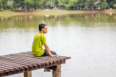 Man sitting near lake Royalty Free Stock Photos