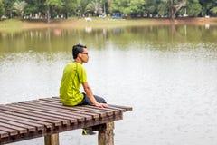 Man sitting near lake Royalty Free Stock Photos