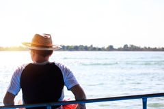 A man sitting near the river. royalty free stock photos