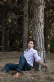 Man sitting near a tree Royalty Free Stock Images