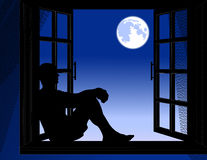 Man_sitting_in_the_night Stock Photography