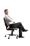 Man sitting on office chair and looking at camera Stock Photos