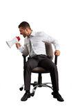 Man sitting on office chair and screaming Royalty Free Stock Photos