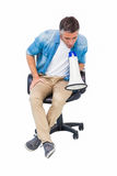 Man sitting on a office chair speaking on megaphone Stock Photography