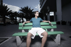 Man Sitting On A Bus Bench Stock Images