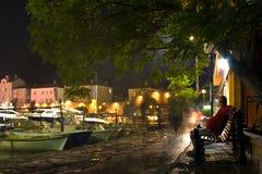 Man Sitting On Mediterranean Waterfront Stock Photography