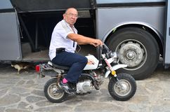 Man Sitting On Moped Royalty Free Stock Photography
