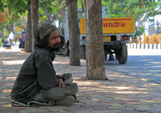 Man is sitting outdoor on ground in Hyderabad, India royalty free stock photos