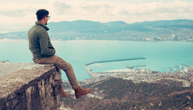 Man sitting over the bay Royalty Free Stock Photo
