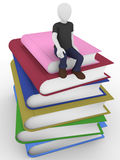 Man sitting over the books Stock Images