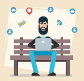 Man sitting in the park on the bench with laptop, working, playing computer games, social networking or texting to his friends. Royalty Free Stock Images
