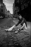 Man sitting on paving road Royalty Free Stock Images
