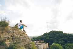 Man sitting on the peak alone with his minds Royalty Free Stock Images