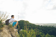 Man sitting on the peak alone with his minds Stock Photography