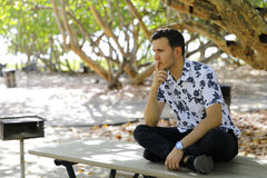 Man sitting and pondering Stock Image