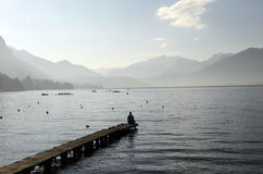 Man sitting on pontoon lake annecy Stock Photo