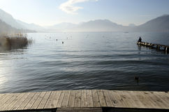 Man sitting on pontoon lake annecy Stock Photos