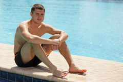 Man sitting by the pool Royalty Free Stock Photo