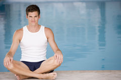 Man sitting poolside smiling Royalty Free Stock Images
