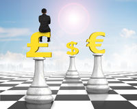 Man sitting on pound symbol of money chess on chessboard Royalty Free Stock Photos