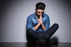 Man sitting and praying Royalty Free Stock Photo