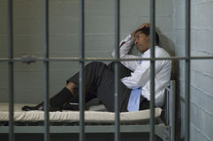 Man Sitting In Prison Cell Stock Photos