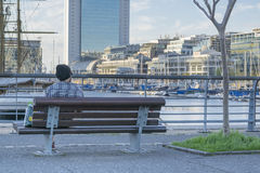 Man Sitting at Puerto Madero Boardwalk in Buenos Aires Argentina Royalty Free Stock Photography