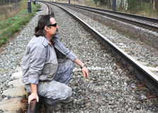 Man sitting on rail tracks Royalty Free Stock Photos