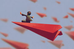 Man sitting on red airplane paper