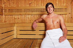Man sitting relaxed in sauna Stock Image