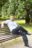 Man sitting and relaxing on a bench. Businessman sitting and relaxind on a bench Stock Photo