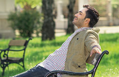 Man sitting and relaxing on bench Stock Photography