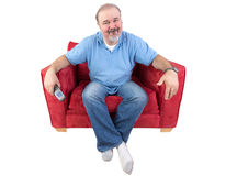 Man sitting with a remote and al bored look Royalty Free Stock Images