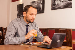 Man sitting in restaurant with laptop,and phone Stock Photo