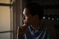 Man sitting in restaurant. Thoughtful man sitting in restaurant Stock Images