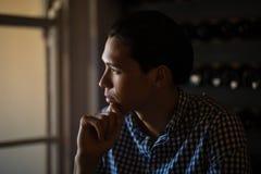 Man sitting in restaurant Stock Images