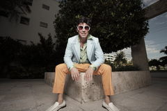 Man sitting in retro clothing Royalty Free Stock Photography