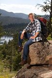 Man sitting on a rock Royalty Free Stock Image