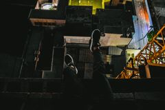 Man sitting on rooftop Stock Image