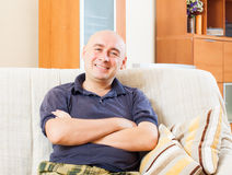 Man sitting in room stock images