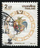 Man sitting on the Rooster. RUSSIA KALININGRAD, 3 JUNE 2016: stamp printed by Thailand, shows a drawing dedicated to Songkran Day (a man sitting on the Rooster Royalty Free Stock Photos