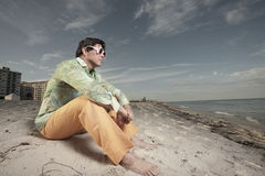 Man sitting on the sand Royalty Free Stock Photos