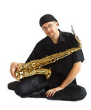 Man sitting with saxophone Stock Image