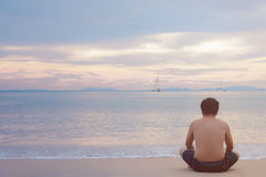 Man sitting see sea alone Stock Images