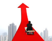 Man sitting on skateboard moving toward red arrow Royalty Free Stock Image